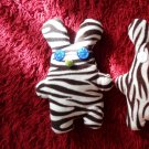 Cute handmade and uniquely designed stuffy bunny: zebra pattern,  blue eyes and green nose