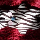 Zebra-pattern handmade and uniquely designed stuffy bunny: light pink eyes and light blue nose