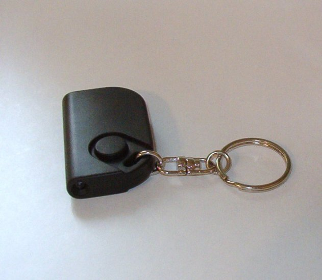 Key Chain with Push Button Light Illuminates Door Entry Palm Size