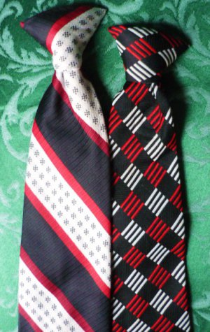 2 Clip On Neck Ties - One is JC Penney Red and White on Blue and Black