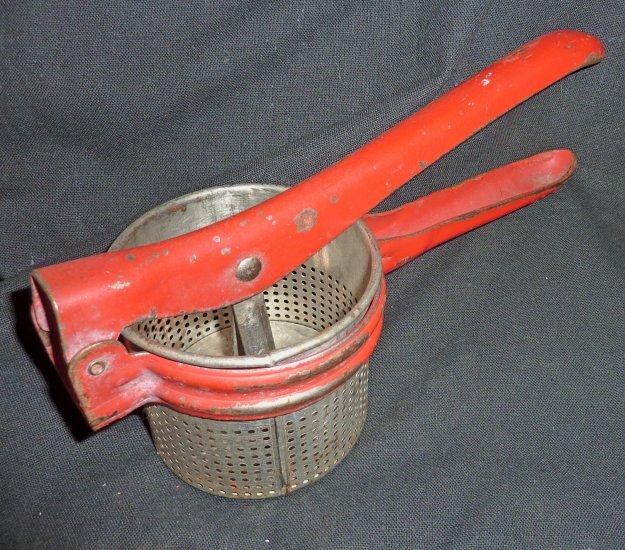 Vintage antique kitchen tool potato ricer masher press