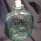 Antique Quart Sized Short Neck Liquor Bottle Embossed Sun and Ivy Design