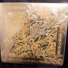 Embossed Gold Leaf vintage Canister on a silver background