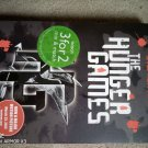 The Hunger Games by Suzanne Collins, Paperback Used Book, Good,