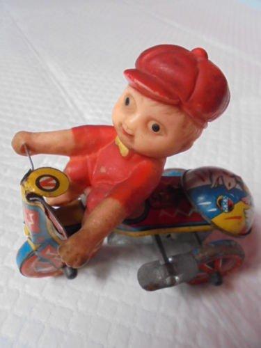 MJU KOREA KID on a motorcycle tin toy wind up mechanism Original 1950s