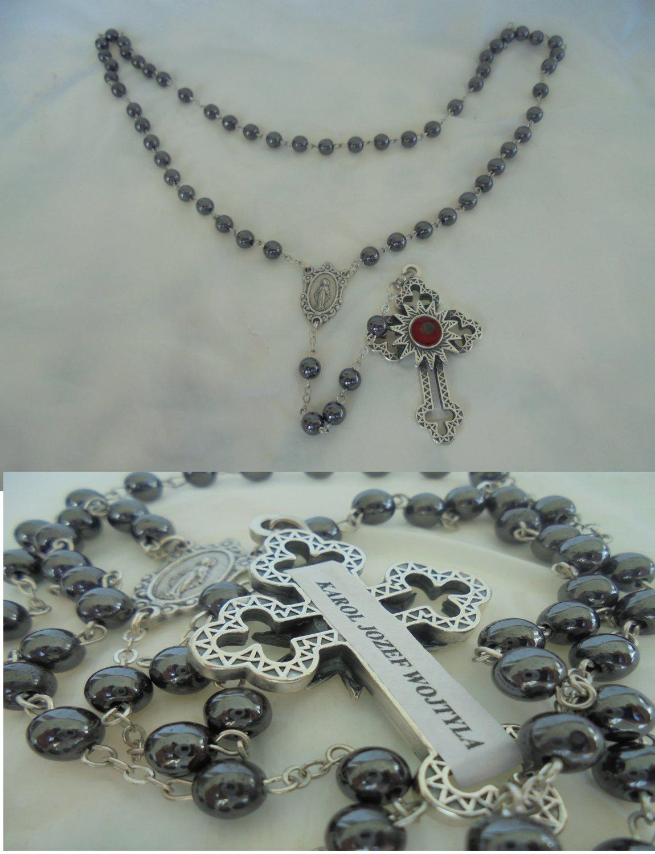 Praying rosary with hematite beads with relic of pope John Paul II Karol Wojtyla santification 2014