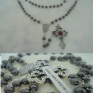 Praying rosary with hematite beads with relic of pope John Paul II Karol Wojtyla santification 2014