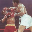 MUHAMMAD ALI HITS LEON SPINKS 8X10 PHOTO BOXING PICTURE