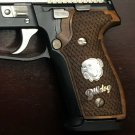 Sig Sauer P226 Legion grips made of walnut wood  with custom logo made of silver.
