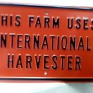 THIS FARM USES INTERNATIONAL HARVESTOR SIGN METAL ADV F