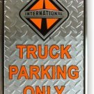 INTERNATIONAL TRUCK DIAMOND EMBOSSED SIGN AD SIGNS