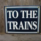 TO THE TRAINS PORCELAIN-COATED RAILROAD SIGN M