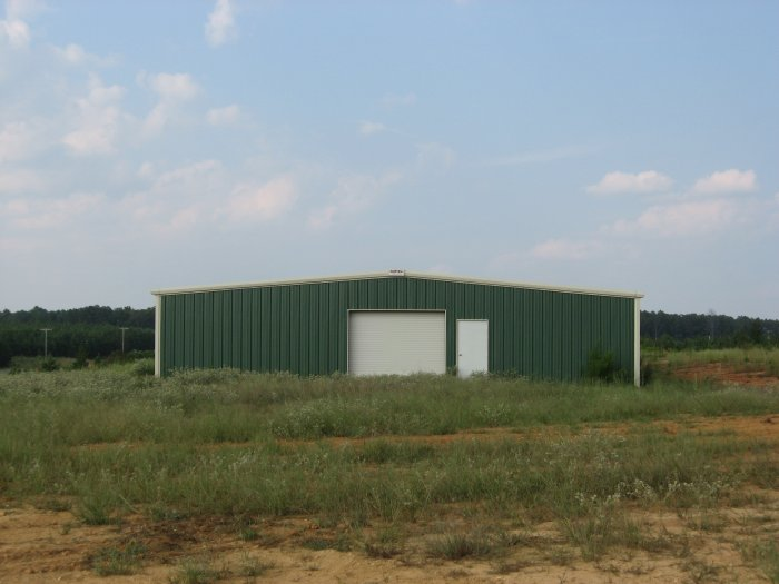 40' x 60' x 12' 1:12 roof slope 1) 10' x 10' F/O Centered Left End Wall.