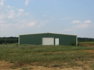 30' x 50' x 12' 1:12 roof slope  1) 10' x 10' F/O Centered on Left End wall.