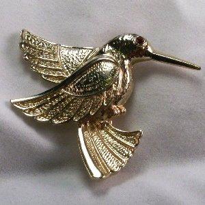 Gold tone Hummingbird pin with red crystal eye