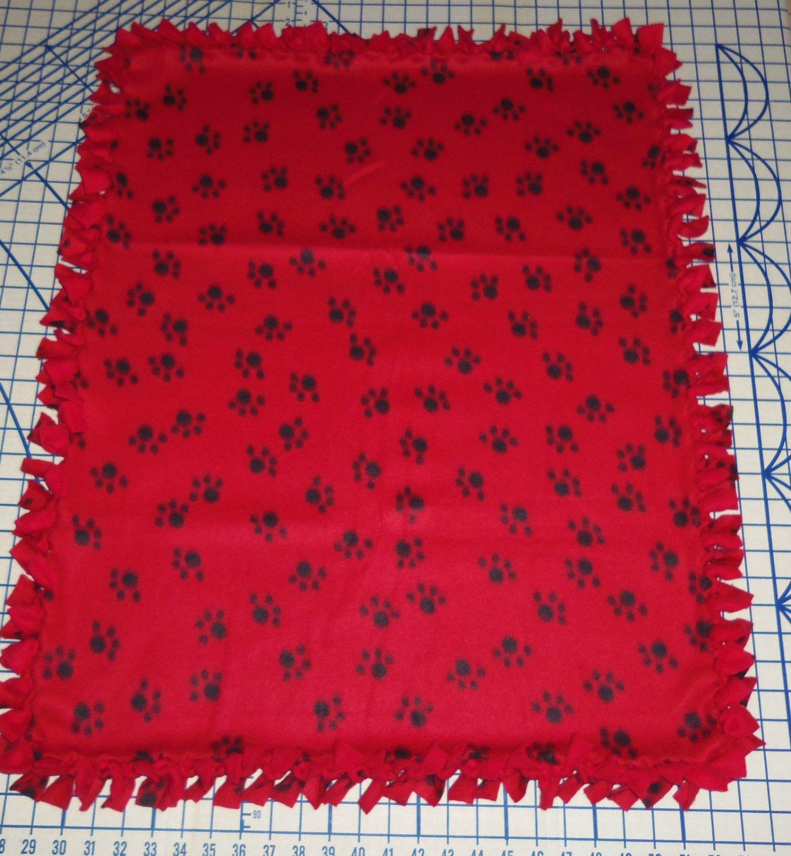 Paw Prints Black on Red Fleece Baby Pet Lap Blanket