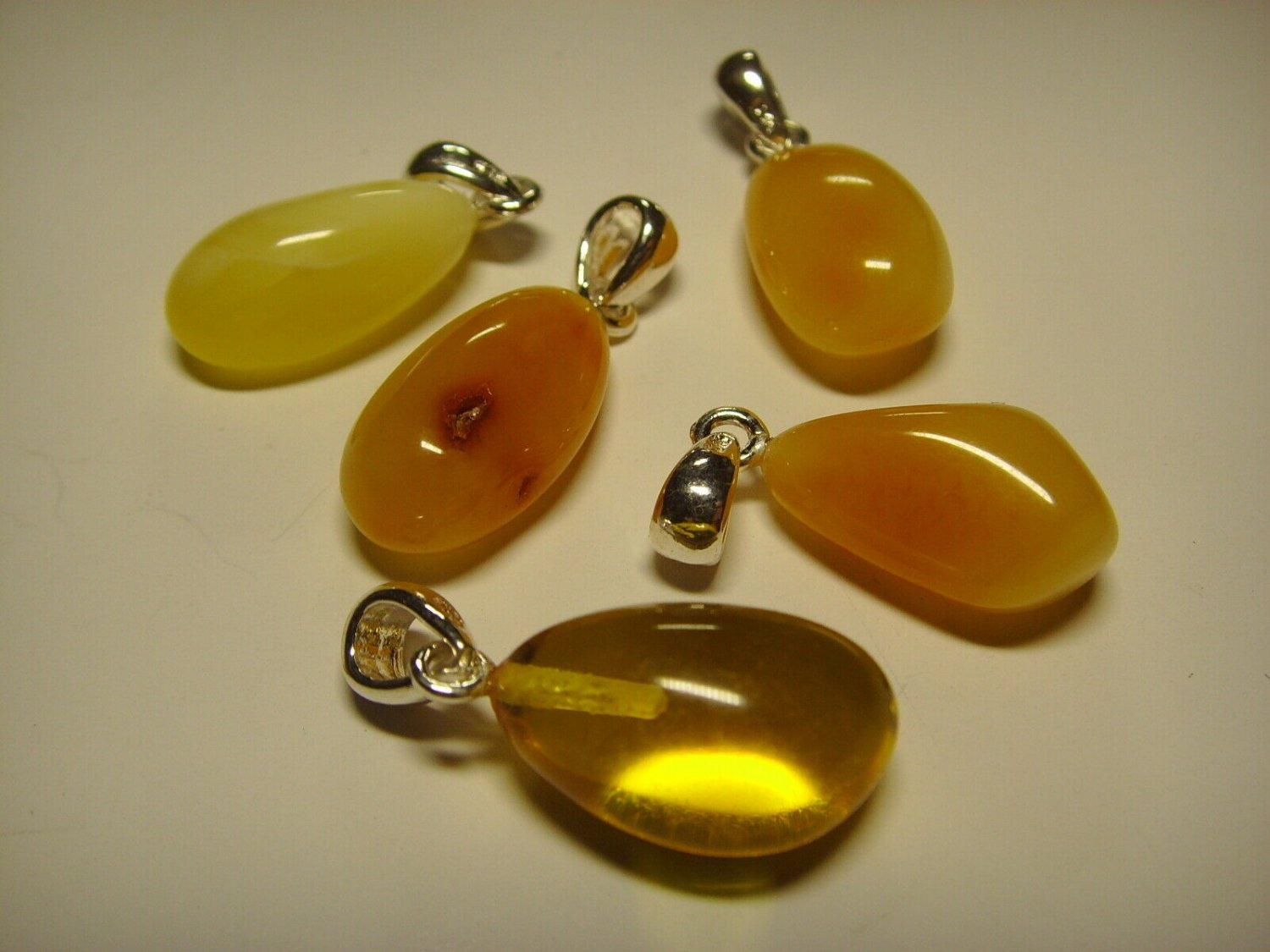 Lot of 5  Genuine Baltic Amber silver Pendants  6.12gr. A-731