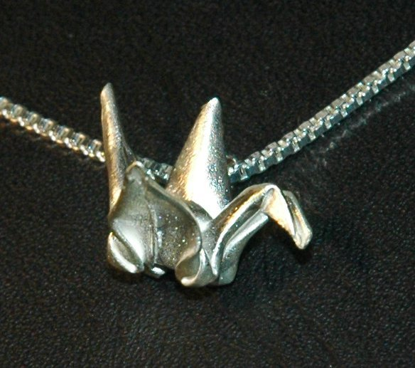 Silver Origami Crane Pendant on a Venetian Box style necklace