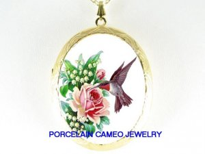 HUMMINGBIRD WITH LILY OF THE VALLEY ROSE CAMEO LOCKET