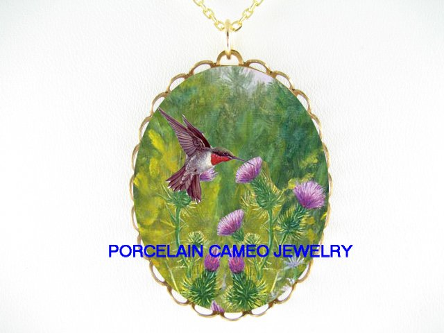HUMMINGBIRD WITH PINK THISTLE PORCELAIN CAMEO NECKLACE