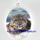 SNOW LEOPARD RESTING IN SNOW CAMEO PORCELAIN LOCKET NK