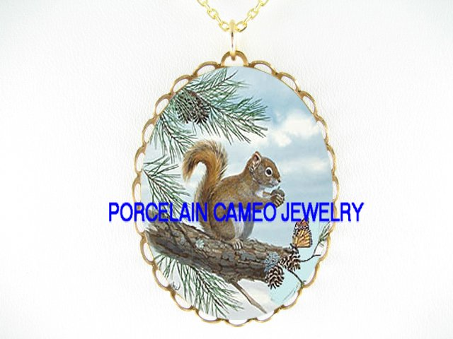 SQUIRREL HOLD NUT WITH BUTTERFLY PORCELAIN CAMEO  NECKLACE