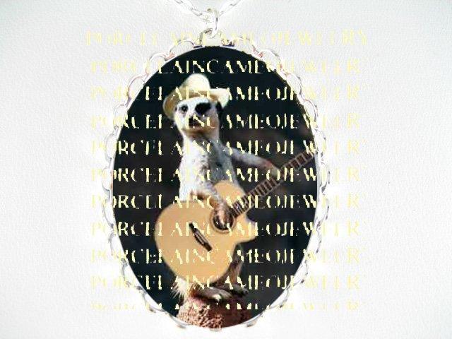 MEERKAT PLAYING GUITAR   *  CAMEO PORCELAIN NECKLACE