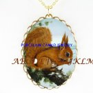 BABY SQUIRREL EATING A NUT CAMEO PORCELAIN NECKALCE