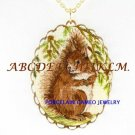 CUTE SQUIRREL WITH PINETREE PORCELAIN CAMEO NECKLACE