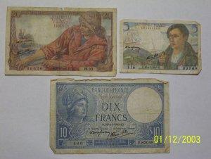20, 10, and 5 Franc bills.