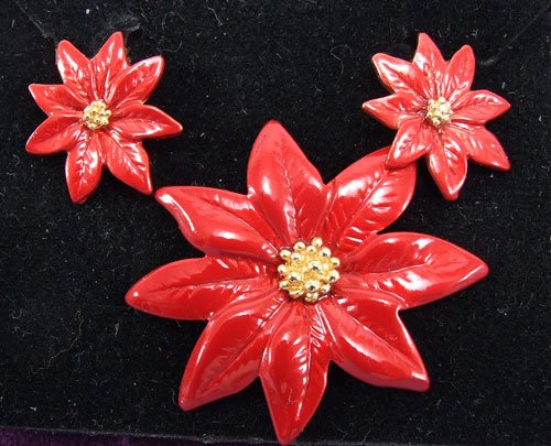 Red Poinsettia Clip Earrings and Pin by Avon from the 1990s