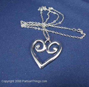 """Silver Heart Shaped Pendant on 12"""" chain"""