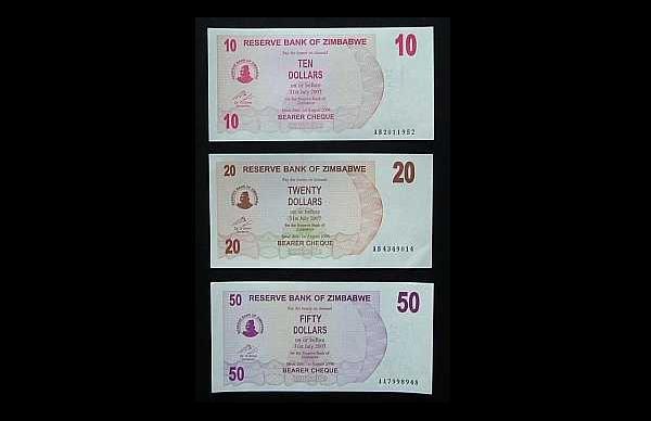 SET OF THREE ZIMBABWE BANKNOTES 2006 10 20 AND 50 DOLLARS