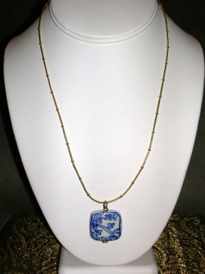 Necklace with blue and white pendant
