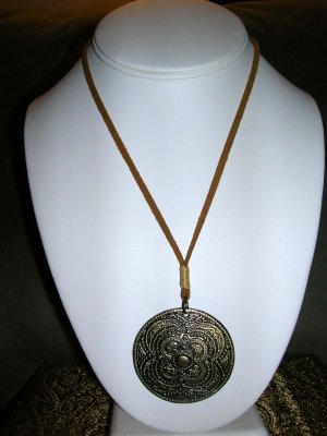 Leather necklace with medallion