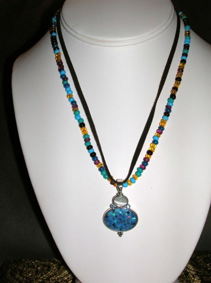 Beaded and leather necklace with blue and white pendant