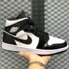 the 1 pair of black white x Jordan's 1 Mid basketball shoes