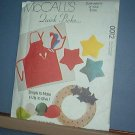 Sewing Pattern McCall's 0012 Apron hat, wreaths, star pillows, dog bed, tied log carrier