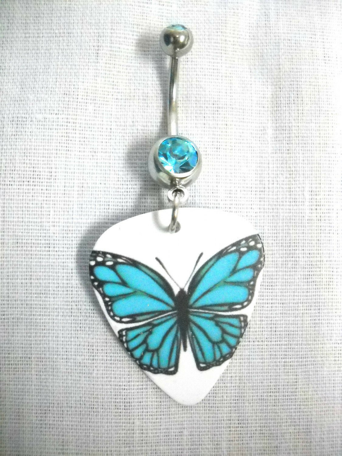 BLUE OPEN WINGS BUTTERFLY PRINT GUITAR PICK - 14g BLUE CZ BELLY RING BARBELL