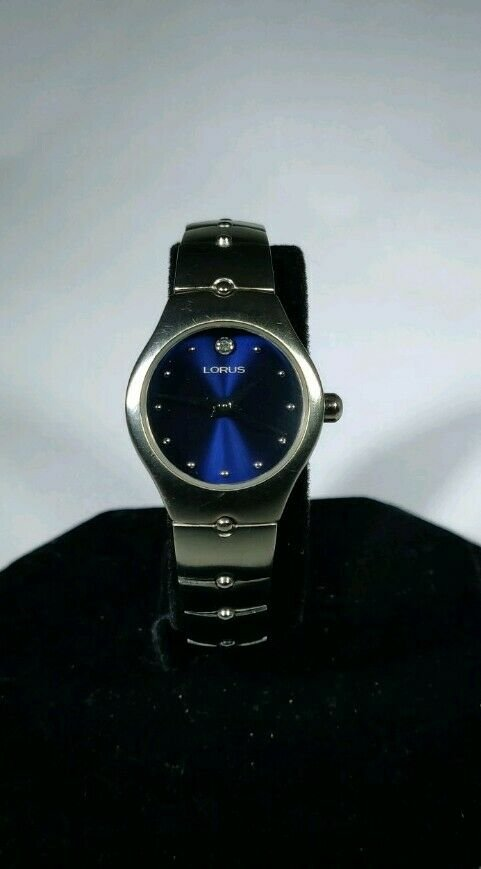 Lorus womens watch brushed silver band blue dial crystal above 12:00