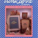 A COUNTRY HOME SAMPLER COUNTED CROSS STITCH BOOKLET by ALMA LYNNE DESIGNS 1986 CRAFT BOOK NEAR MINT