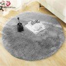 Fluffy round grey rug