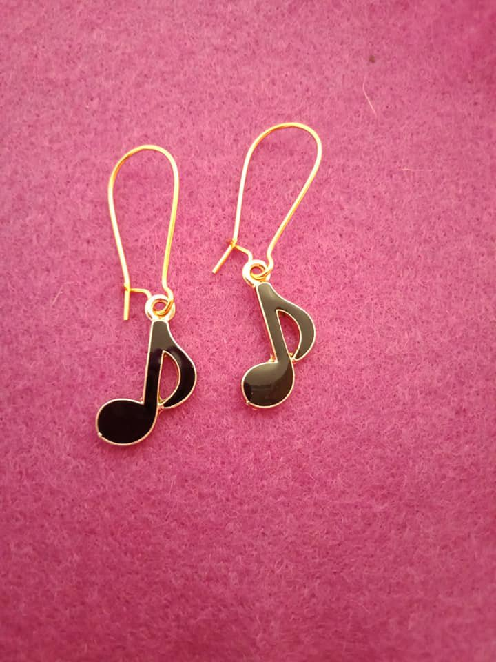 Gold and black music note earrings