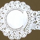 Doily hand crocheted with manufactured lace insert around linen center