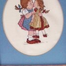 Completed finished counted cross stitch girl kissing doll 12 x 15 matted framed