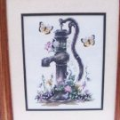Completed finished counted cross stitch vintage water pump in garden framed