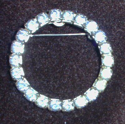 Vintage blue rhinestone pronged pin circle silver tone setting jewelry