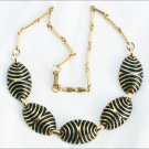 Vintage necklace gold tone metal with black enamel accents circa 1960s jewelry