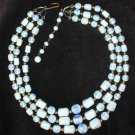 Plastic bead necklace 3 strands blue and white beads