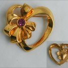 Avon heart and bow pin gold tone pink rhinestone accent